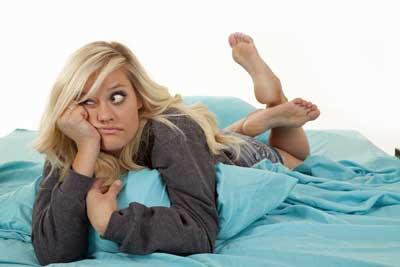 Woman-lying-bed.jpg